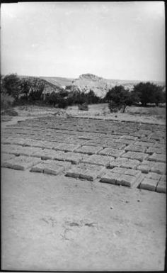"Maria Chabot, ""Adobe Bricks,"" 1946. Contemporary photographic print, 9 5/8 x 6 3/16 in. Georgia O'Keeffe Museum. Gift of Maria Chabot. RC-2001-002-025a. Copyright Georgia O'Keeffe Museum."
