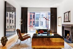 A view you don't want to cover up. A stunning living room from New York. Architectural Digest