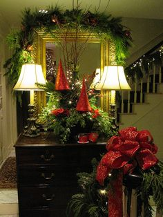 Christmas foyer ideas using red glass trees and fresh greens ~ just pretty