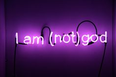 'I am not God' neon by artist Kiron Robinson