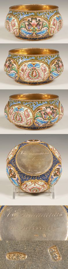 A russian silveerr gilt and shaded cloisonne enamel bowl, Feodor Ruckert, Moscow, circa 1896-1908. The circular bowl with raised oval lobes decorated in shaded multi-color floral and foliate motifs with alternating grounds of cream and peach against an overall olive green ground.