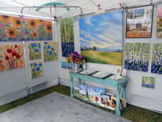 Kristina Wentzell Fine Art- I like how welcoming this booth is. She's got a great little info table with flowers and a landscape painting above it.