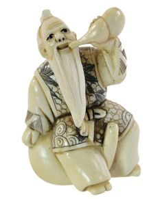 "A hand carved and polychrome scrimshawed ivory netsuke depicting a male figure drinking. Signed on bottom. Measures approximately 2.25"" x 1.25"" and weighing 20 grams."
