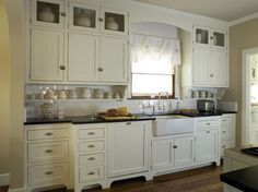 Like This Sink And The Cabinets That Go All The Way Up! This Quaint Cottage  Kitchen Features Antique White Shaker Cabinets, Black Countertops And A  White ...
