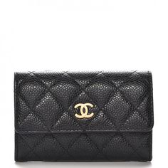 3d5401c220f4 This is an authentic CHANEL Caviar Quilted CC Card Holder in Black. This  simple and