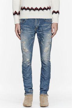 SAINT LAURENT Light blue destroyed jeans