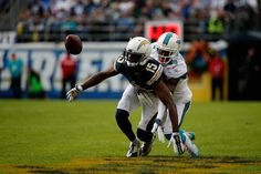 Bobby McCain Photos Photos - Dontrelle Inman #15 of the San Diego Chargers is defended by Bobby McCain #28 of the Miami Dolphins at Qualcomm Stadium on December 20, 2015 in San Diego, California. - Miami Dolphins v San Diego Chargers