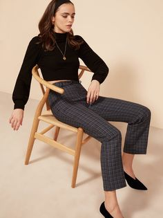 If you have to wear pants. This is a high rise pant with center front closure, back pockets, and a slightly cropped leg.