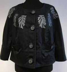 zwart jasje met bladeren opdruk