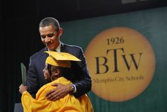 US President Barack Obama greets a graduate after she received her diploma at the Booker T. Washington High School graduation ceremony May 16, 2011 at the Cook Convention Center in Memphis, Tennessee. The school is the winner of this year's Race to the Top High School Commencement Challenge. AFP PHOTO/Mandel NGAN (Photo credit should read MANDEL NGAN/AFP/Getty Images)
