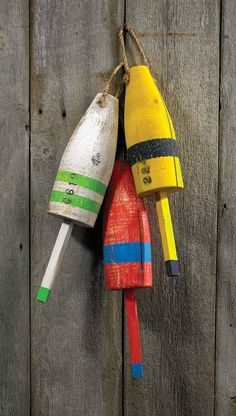 Maine buoys. If you travel Route 1 along the coast of Maine, these colorful wooden buoys will become very familiar to you along with fishing nets and lobster traps.