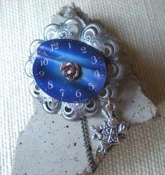 Steampunk Jewelry: Alice in Wonderland - Steampunk Brooch - Steampunk Fashion - Steampunk Costume. $20.00, via Etsy.