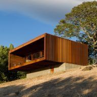 Marc Mogas slots prefab summer home into wooded slope in the Pyrenees