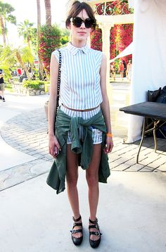 Alexa Chung in sleeveless top with matching shorts and jacket tied at waist