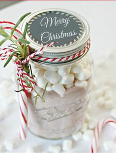 To make Homemade Hot Cocoa in a Jar, throw hot cocoa mix and marshmallows in a jar,then add a festive chalkboard label and a candy cane—then congratulate yourself for making the easiest holiday gifts ever. Mason Jar Christmas Gifts, Neighbor Christmas Gifts, Mason Jar Gifts, Neighbor Gifts, Homemade Christmas Gifts, Noel Christmas, Great Christmas Gifts, Homemade Gifts, Holiday Gifts