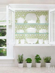 Low-Cost Cabinet Makeover Ideas You Have to See to Believe Fake the look of a full-blown kitchen remodel with this super-easy idea. Hang wallpaper in the back of glass-front cabinets to elevate the contents to works of art. Here, geometric-print green-and Wallpaper For Kitchen Cabinets, Glass Front Cabinets, Refacing Kitchen Cabinets, White Kitchen Cabinets, Painting Kitchen Cabinets, Dark Cabinets, Open Cabinets, Shaker Cabinets, Distressed Kitchen