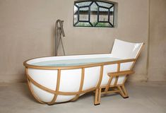 Studio Thol Bathtub  Daring design in the form of American white oak and marble composite seen at Milan Design Week