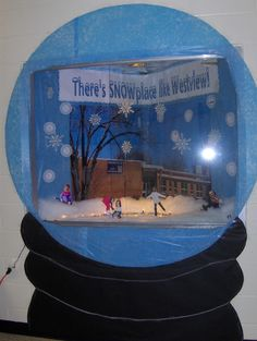 The skaters are the office staff and principal faces on kids bodies. I put an enlarged picture of the school in the background. The display resembles a snowglobe.