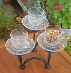 What do you do with a heap of small, glass cups and saucers and an old candelabra? Make a bird feeder of course!! This feeder could stand in your garden near a bush or be hung from a low branch. One cup could be kept as a 'water dish' for the feeding birds to enjoy.    Tags: Bird Feeder, Repurpose, upcycling glass dishes, garden junk, cup and saucer birdfeeder, op-shop, Made By Mim