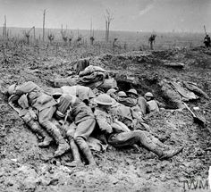 WWI, 11 Oct 1917; Exhausted stretcher bearers from the 3rd Australian Division rest in the mud and drizzle of Broodseinde Ridge, during the Third Battle of Ypres (Passchendaele). Cropped. © IWM (E(AUS) 941)