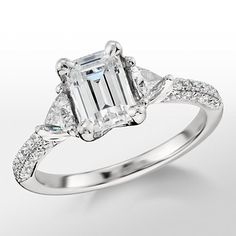 Monique llhulier trillion cut ring, emerald cut of course. 1.3 carat emerald in the middle. Holy perfection. NEED NEED NEED