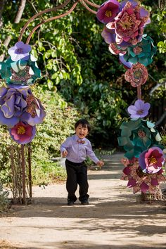 Giant paper flower garden arch using japanese chiyogami yuzen washi cutie pie ring bearer in a lavender shirt with a washi paper bow tie under a mightylinksfo Gallery