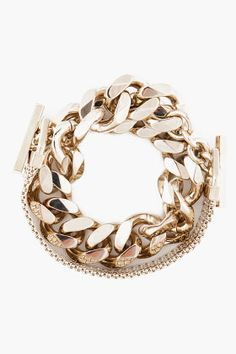 Givenchy : Wrap around style bracelet in gold tone. Large chain link bracelet with bar hooks at tips. Box chain bracelet with rings and logo engraving at tips.