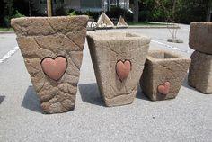 Great Way to use all those heart rocks I find...put into a hypertufa pot!