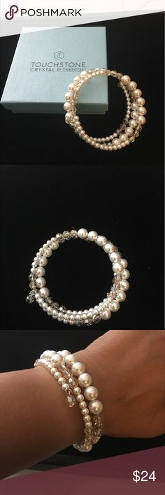 Touchstone Crystal Pearl Wrap Bracelet Touchstone Crystal by Swarovski White crystal pearls and Golden Shadow faceted crystals create a lovely classic bracelet. Fits most wrists. Display only. Touchstone Crystal by Swarovski Jewelry Bracelets