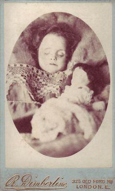 A genre of post mortem photography known as 'The Sleeping Beauty', in which the desired effect on the part of the photographer is to make it appear that the deceased is only asleep.    The photographer R. Dimberline of 325, Old Ford Road, East London.