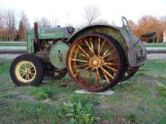 Old Farm Machinery Collection On US 31 - West Olive, Michigan - Antique John Deere Tractor by randomroadside, via Flickr