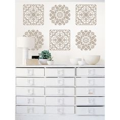 Add extra elegance to your kitchen decor with this detailed wall decal set from Wall Pops. Made of self-adhesive vinyl, the pieces in this set are easy to hang and simple to clean. They can be moved from room to room when you feel like it.
