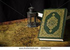 Koran - holy book of Muslims  with  lantern - stock photo
