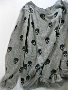 Cute slouchy sweater with skull print. It would look adorable with a lace mini-skirt!
