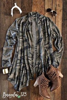 French Terry Waterfall Cardigan in shades of Olive, Gray, and Taupe allover Camo print. Ultra-soft and comfortable! Great with denim and booties for the season. Model is wearing a size small. Runs tru