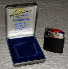Vintage Ronson Varaflame Liteguard Butane Cigarette Lighter.