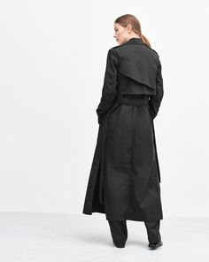 This lightweight open-front trench is cut for a timeless, flattering fit and comes with an accompanying self-belt at waist. It features unstructured shoulders and has a sculptural yoke detail at back. Wear yours open as a light layer over a dress, or cinc