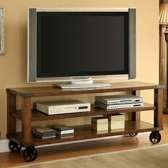 Features:  -Collection: Howie .  -Frame construction: Wood, metal and veneers.  -Wooden tabletop and shelf.  -Decorative metal accents.  -Two open shelves for placement of electronics.  -Décor and acc