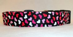 This collar is full of LOVE! and WE LOVE IT! Awesome Pink Red and White Hearts on Black Dog Collar!