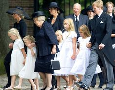 Members of the Dutch royal family including Prince Friso's mother Beatrix, his widow Mabel and two daughters Luisa and Zaria held each other closely