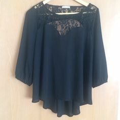Black Lace Soprano Blouse Super cute black lace blouse with low back. Lightly worn and still in good condition. Soprano Tops Blouses