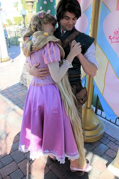 Rapunzel and Flynn dancing and Rapunzel is standing on Flynns feet, so adorable!!!!