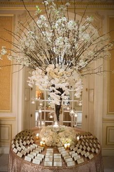 Escort Card Table Inspiration: Towering cherry blossom branches combined with white roses, hydrangea, and falling orchids add romantic elegance to the presentation. Table Seating Chart, Wedding Table Seating, Card Table Wedding, Wedding Dinner, Reception Table, Branch Centerpieces, Wedding Table Centerpieces, Wedding Decorations, Centrepieces