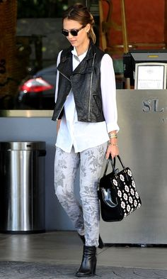 Great pairing of a black leather vest, white button down and gray floral jeans