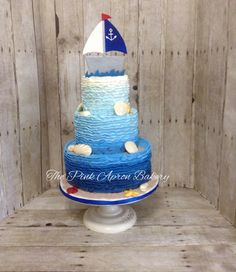Blue ombre, buttercream ruffle, nautical baby shower cake.