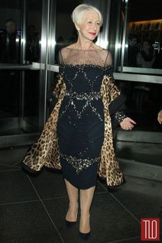 "Helen Mirren attends the premiere of ""Women In Gold"" at the Museum of Modern Art in New York City in a Badgley Mischka dress paired with a black coat with a leopard print lining"