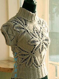 Lovely lace top. It's an improvised pattern too. Very clever!