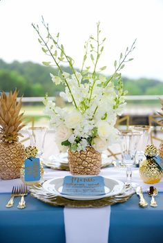 This centerpiece is made with real pineapples that were spray painted gold and stuffed with real flowers! Ive never seen anything like this. Its stunning and so unique. This is a great idea if you want to have a tropical wedding with a formal vibe.