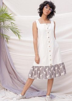 knee length, A line dress with gathered layer of printed fabric, square neck, cut sleeves, side pockets and wooden buttons. Cotton Dress Indian, Cotton Dresses, Indian Fashion Dresses, Fashion Outfits, Frock Models, White Boho Dress, Kurta Neck Design, Tent Dress, Fabulous Dresses