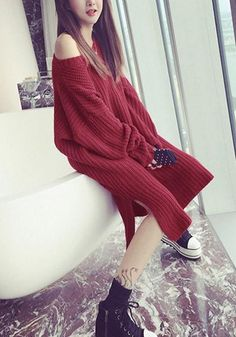Girl in burgundy side-slit sweater dress and booties